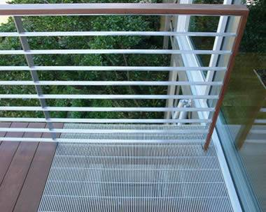 Balcony covered by aluminum close mesh grating for good ventilation