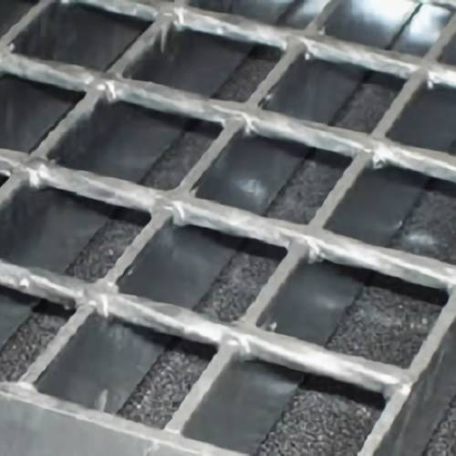 Welded grating with plain surface