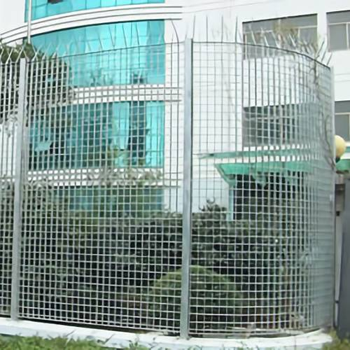 Welded steel grating fence around a commercial building